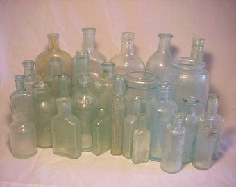 c1880s-1890s Collection of 26 Different Aqua Glass Embossed Cork Top Medicine, Bitters, Food and Household Bottles in Nice Aged Cloudy Glass