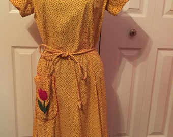 Vintage 1950s dress- Golden Yellow and Red Print Cotton Swirl Wrap Day Dress with Tulip Pocket Applique