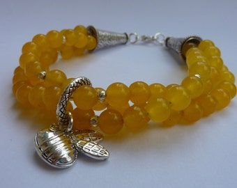 Bracelet: A handful of sunshine triple strand semi precious yellow Jade with Tibetan silver and a Swarovski Elements bumble bee