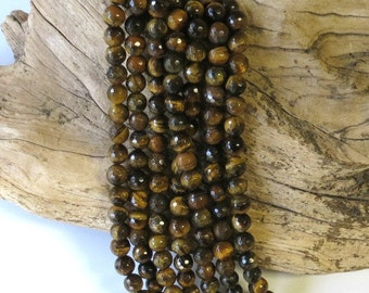TigerEye - Faceted Tiger Eye - 8mm Round - 15 1/2 Inch Strand of 47 Beads