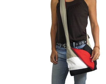 crossbody bag with flap closure and two zipper pockets. ready to ship and sale priced.