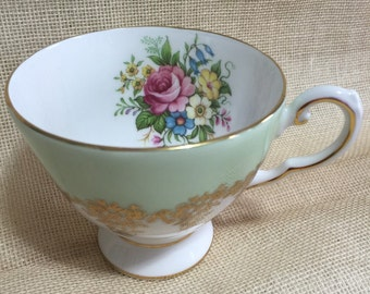 ROYAL TUSCAN fine bone china teacup  Beautiful mint green and gold on the outside and a floral design on the inside of cup.