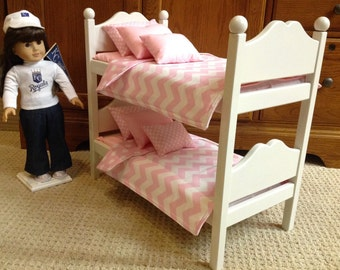 White bunk bed with baby pink chevon and dots bedding for the 18 in American Girl Doll