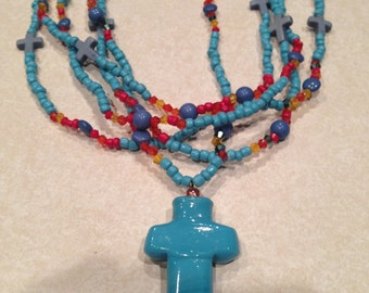 Turquoise colored Five Strand Beaded Necklace with Ceramic Cross