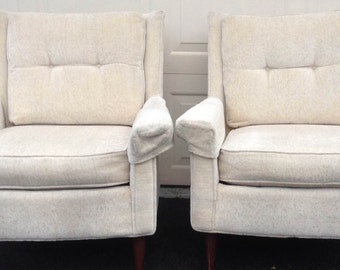 Two white upholstered Mid Century arm chairs