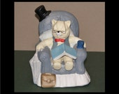 1995 vintage sleeping cat in chair figurine with book glasses coffee umbrella top hat bag vest bow tie pillow GEI bisque