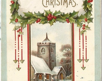Country Christmas in a Snow covered Winter Church Scene A Happy Christmas Framed in Holly Branches Vintage Postcard
