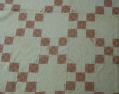 Antique quilt:  nine patch in a nine patch   hand quilted cotton fabrics in shabby chic condition.