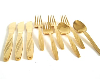 "Gold Silverware American Stainless USA Electroplate ""Flair"" Flatware and 1 unmarked spoon"