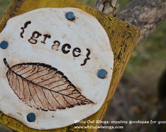 Grace clay leaf and word impression on wood block