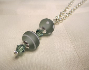 Stripes and Polka Dots Lampwork Bead Necklace in Sage Green and White