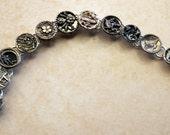 A silver button bracelet