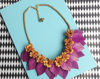 Purple leaf and gold flower necklace