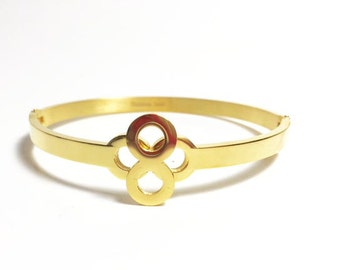 Infinity Clover Loop Stainless Steel Gold Plated Bangle. Hypo Allergenic jewelry.