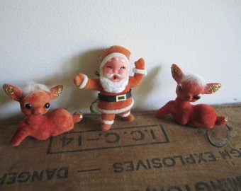 Vintage Santa and reindeer fawns Christmas decor