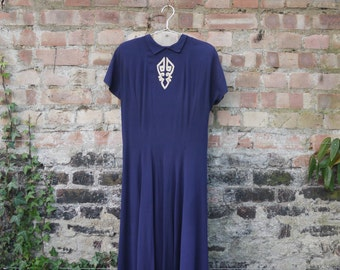 1940s navy rayon crepe dress with cream embroidery at neck