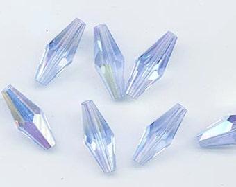 Twelve vintage Swarovski crystal beads - Art. 5205 - 20 x 8 mm - light sapphire AB