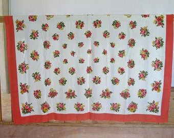 French flowery tablecloth with pink and yellow flowers with coral border