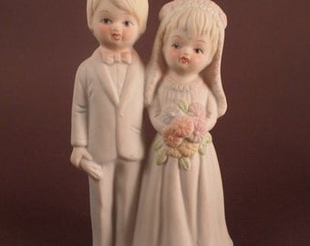 Vintage Bride and Groom Cake Topper, Dressed in White with Pink Highights, Bisque