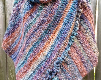 Crocheted, ruffled, buttoned wrap in sunset colors