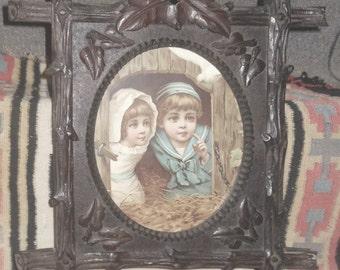 Victorian  folk art oval hand carved walnut picture frame