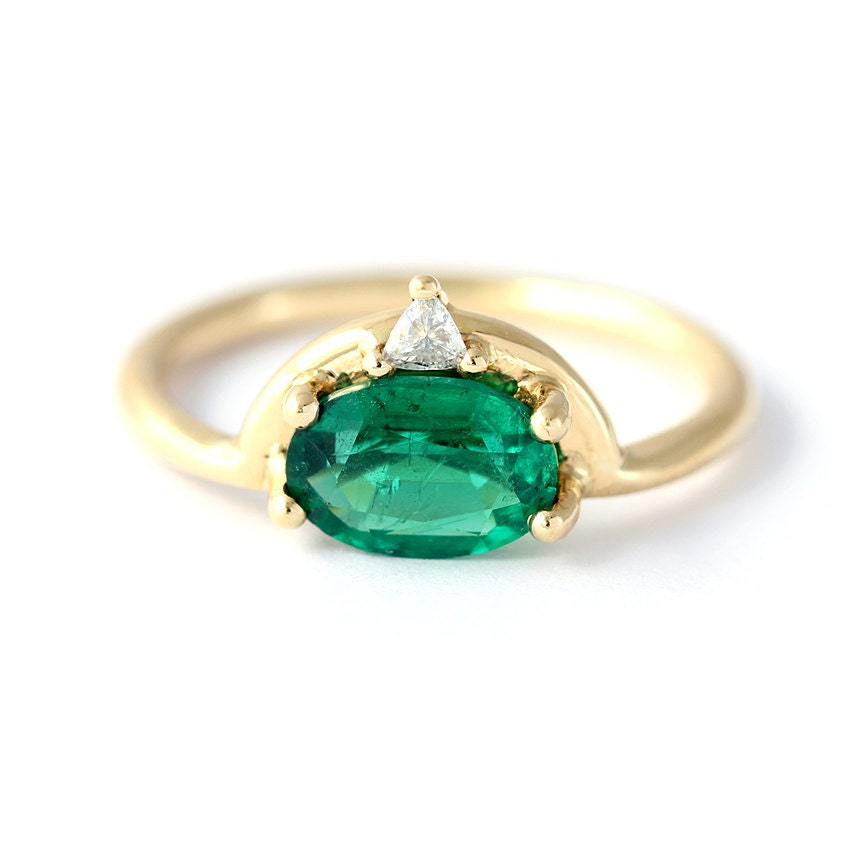 emerald engagement ring with trillion by artemer