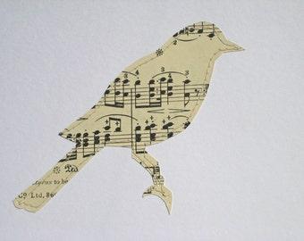 A SONG BIRD - hand paper cut from Vintage Sheet music // map art // paper cut