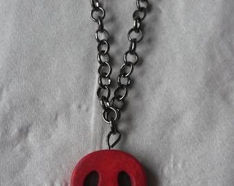 Red skull pendant on Gunmetal Chain