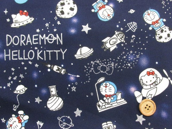 Doramemon and sanrio hello kitty in space navy blue for Space kitty fabric