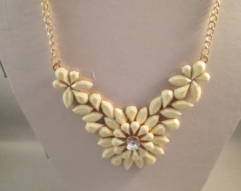 Gold and Ecru Pendant Bib Necklace on a Gold Tone Chain and a Clear Crystal Center