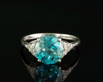 A superb Art Deco 5.80 Ct natural blue zircon and diamond platinum ring