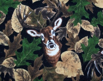 Clever Deer fabric features deer cleverly blending in with the trees