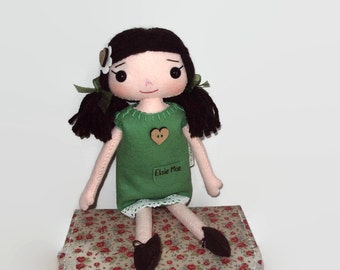 Rag doll with green, heart button dress. Can be personalised