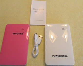 Portable Power Bank Charger. Charges any Electronic, ie All Tablets cell & Smart phones etc.