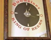 Vintage Budweiser King Of Beers Mirror with Clock It keeps good time.  Labeled OFFICIAL PRODUCT by St Ives Clock Corp