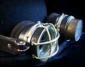 "Steampunk goggles in dark brown leather with  brass ""protective cage"" and perforated plate."