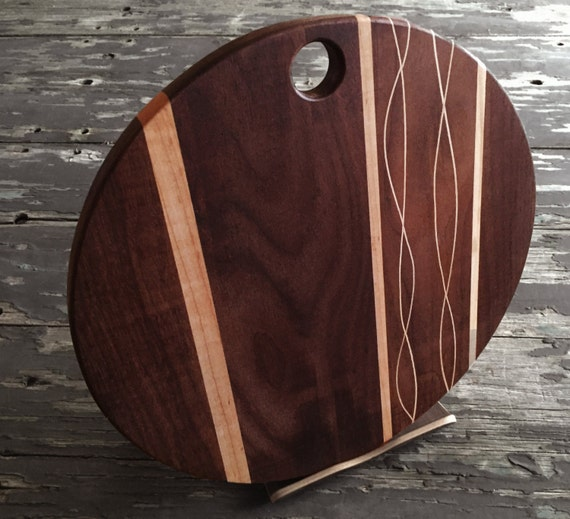 Gorgeous Walnut and Maple serving platter or cutting board, 12 inch diameter