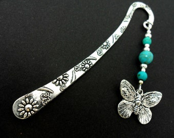 A tibetan silver and turquoise bead butterfly charm  bookmark.