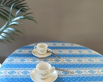 round cotton tablecloth Esterel in blue.Fabric from Provence, France. 50'' to 62'' diameter. Matching napkins available.