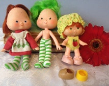 3 Strawberry Shortcake  Dolls  some clothes  as is lot cherry cuddler and Lime Chiffon american greetings