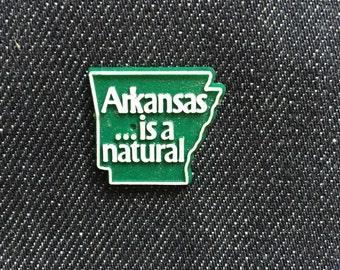 "Vintage Plastic ""Arkansas is a natural"" Lapel Pin"