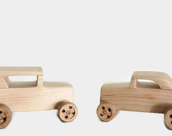 Two handmade wooden toy cars