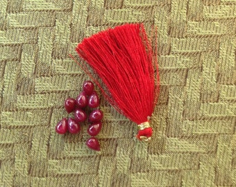 10 red beads and 1 red tassel