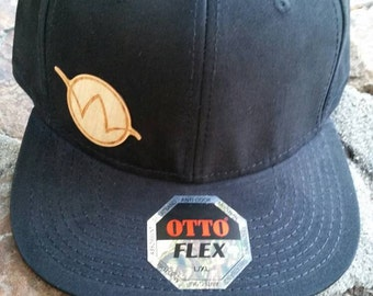 Wasteland Oddities Flex fit Flat Bill Cap L-XL with wooden Wasteland Oddities logo permanently attached.
