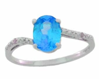 14Kt White Gold Blue Topaz & Diamond Oval Ring