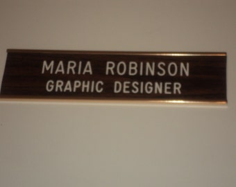 """2"""" x 8"""" - Rosewood/white letters - gold anodized aluminum wall holder - 2 holes & adhesive backing - 2 lines"""