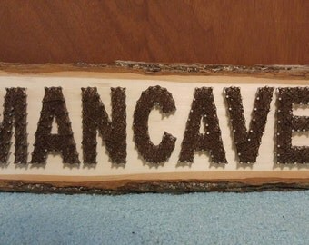 Brown MANCAVE String Art on Tree Bark Plaque