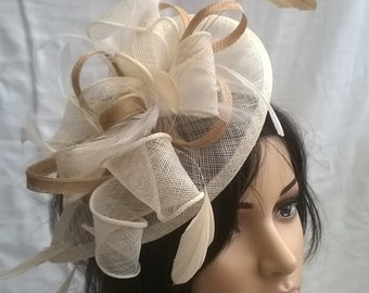 Ivory & Pale Gold Fascinator..Stunning Ivory Fascinator ..Sinamay and  Feather Teardrop style  with  swirls ,coque Feathers