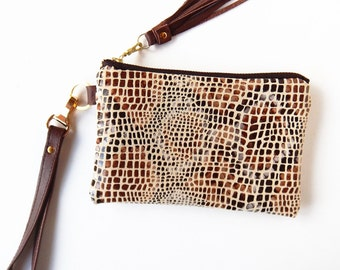 Leather wristlet in patent reptile print.  Reptile print leather pouch.