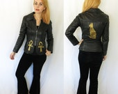 Vintage 80s DISTRESSED black LEATHER Peplum Jacket w hand painted Egyptian Cat Ankh in Gold on Back- Small